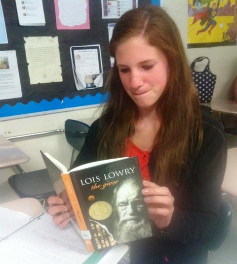 "Engaged with the story that is unfolding before her, Sarah Klein, freshman, comments, ""The book has an interesting story, but has some dull moments."""