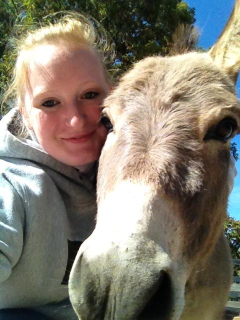 Courtney Rovneyko and Carlos the donkey at Save The Horse.