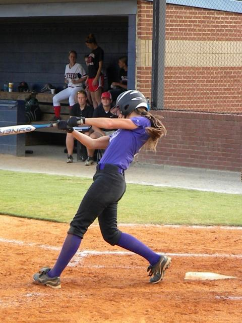 Katie York whacks the ball, helping the NFHS varsity softball team to victory once again.