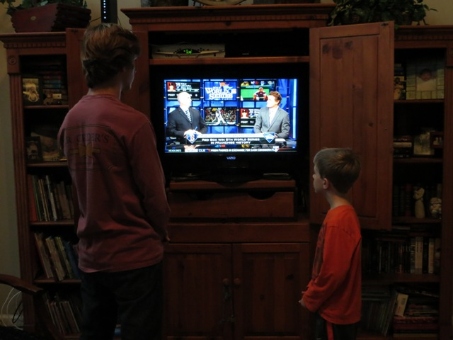 Allen Carter and his younger brother watch highlights from the 2013 World Series.