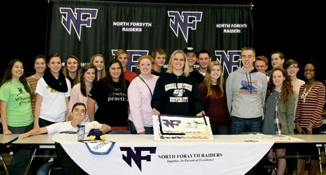 Kaylyn Thomas with the North Forsyth High School Swim Team and her friends.