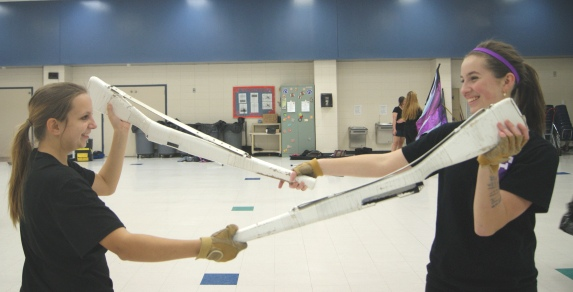 Rachael Hosea (Left) and Katie Shumacher (Right) practicing with their equipment.