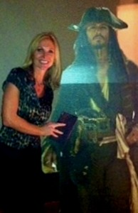 Mrs. Carpenter posed next to her dream. She makes an effort  to express her love for Johnny Depp to her students by showing his face on her classroom walls.