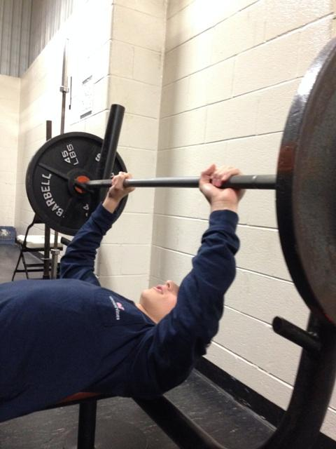 A student hits the gym, working for his New Year's Resolution.