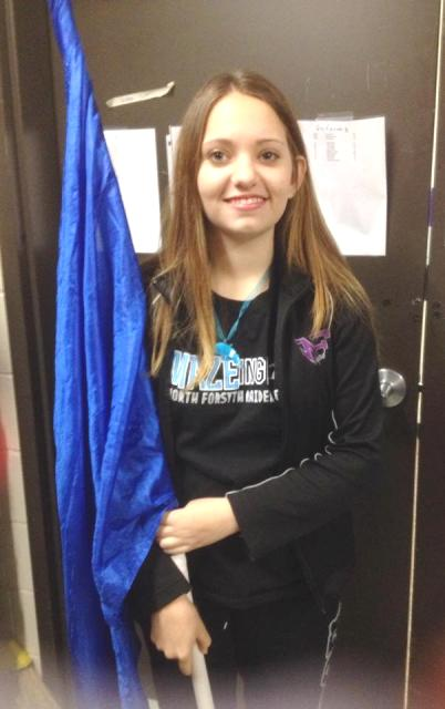 Lydia Thompson, a member of the winter guard, with her equipment.