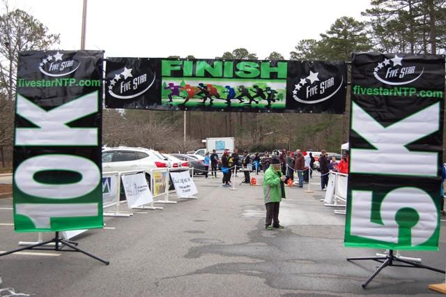The finish line meets every participant at the end of each race and spectators wait eagerly for the runners to cross it.