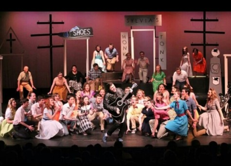 "Cindy Grant captures lead Jason Gardner singing the Elvis Presley classic ""C'mon Everybody"" surrounded by the Town's People in Wednesday's breathtaking performance of All Shook Up! Cindy Grant has given permission to use this photo."