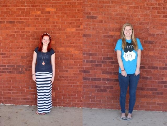 Emily Raham and Meghan Lee smiling very enthusiastically as they have their photo taken outside of the school.