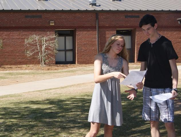 Confused freshmen Anna Grace Brown and Caleb Ferguson dive into debate to discover the depths of their new schedules.