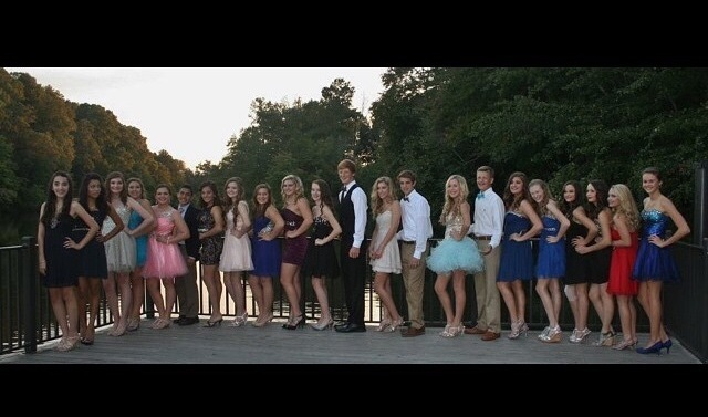 "Many young men and women lined up on a dock to take a photo before going to Homecoming. Everyone's bright smiles show how excited they are for the dance. Mckenna Watson, a freshmen at North Forsyth High School, exclaims, ""I've been waiting for this night to come all week. I can't wait any longer!"""