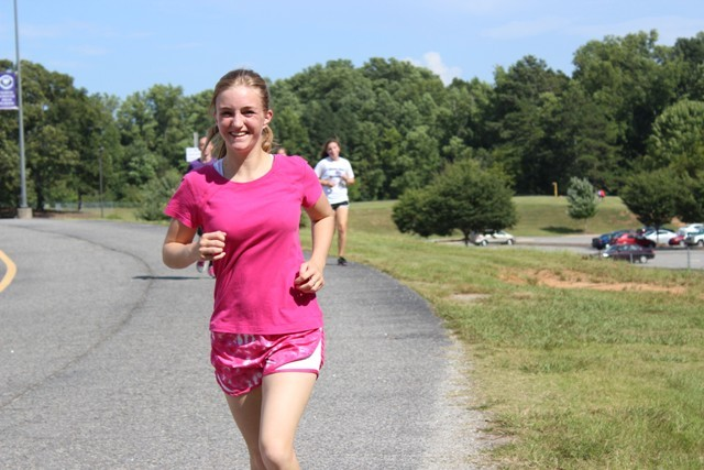 Runner Madison Hill practices after school with her cross country team.  Although she did not compete in the Sharptop Invitational, she ran a personal record of 24:11.37 in the three mile run on September 27th.  Photo by Maddie James.