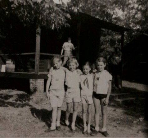 "Jane Poe, second from the right, will always remember her days as a young woman at Girl Scout camp. ""Associating with girls that shared my interests and also brought different opinions and talents to share during our meetings was so wonderful for me at that age,"" Poe says. Camaraderie is just one of the skills she learned as a Girl Scout, and she still puts it to use daily."