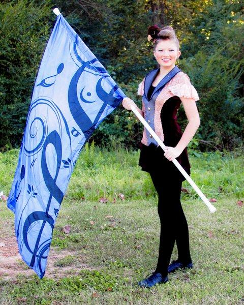 Many members already involved in guard are very passionate about the sport. They dedicate a lot of their time and strive for a perfect performance. Photo given with permission by Heather Sweet.