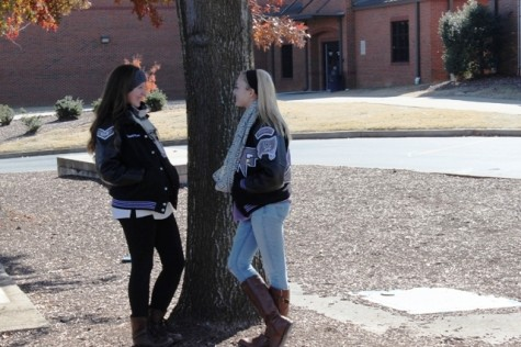 Students Delaney Williams (left) and Channing Cooper (right) shiver with both cold and fear of upcoming midterm exams. Students live in constant fear of failing their midterm exams. Midterm exams accompany the gloomy December weather, which reflects feelings of impending doom and encroaching academic apocalypse.