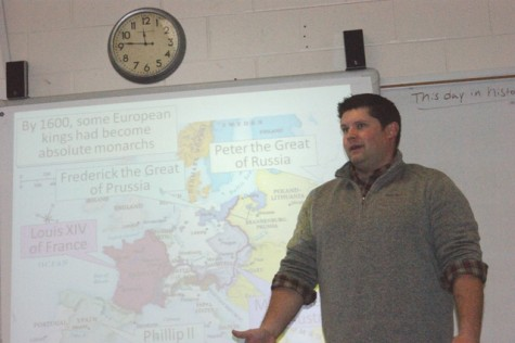 "Jake Castleberry, the new on level world history teacher, lectures about the reign of absolute monarchs. He joined the staff this year and was a bit anxious, but is settling in well. ""I love being here. I graduated from NFHS back in 2001, and I'm just excited to be part of this team of awesome teachers in the social studies department."""