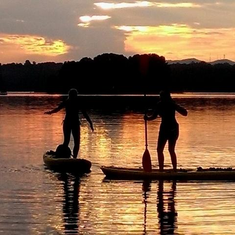 Since kayaking is such a simplistically exciting activity, hitting the waters is now possible at any time of the day. Central Bulldog Sophomore Maria Hansen and younger sister Laney Hansen love making the fifteen minute drive to Lake Lanier just before the sun sets and catching the oranges and yellows cast upon the water.