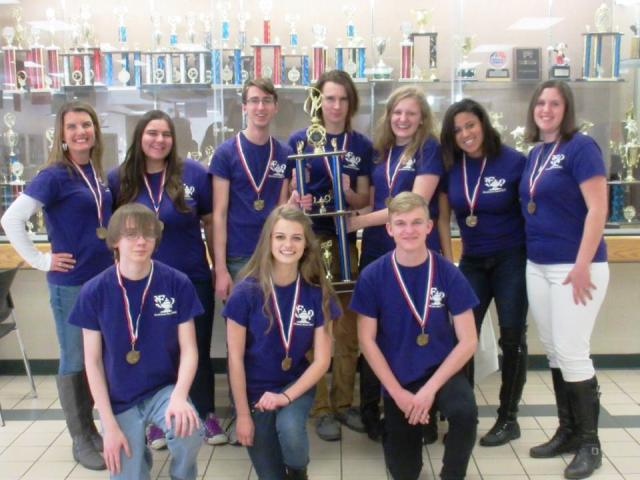 The+Academic+team+basks+in+their+glory+once+again+while+holding+onto+their+1st+place+trophy.+Photo+Taken+by+Amy+Dykes