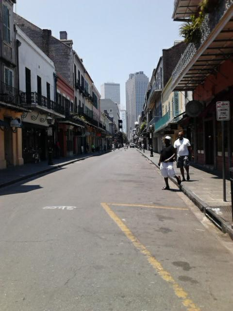 People roam the streets of Downtown New Orleans, Louisiana enjoying the day before the afternoon storm.