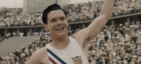 (Screenshot from YouTube). A young Louis Zamperini sprints through the finish line at the Olympics.
