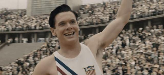 %28Screenshot+from+YouTube%29.+A+young+Louis+Zamperini+sprints+through+the+finish+line+at+the+Olympics.++
