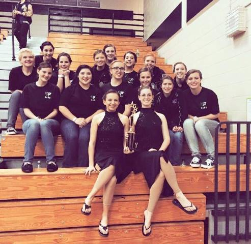 The NFHS Winter Guard proudly smiling after their first place win this season.