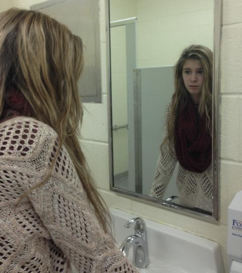 Looking in the mirror should reflect oneself, not the image of what others want. When someone looks in the mirror, they should be happy with the person standing on the other side.