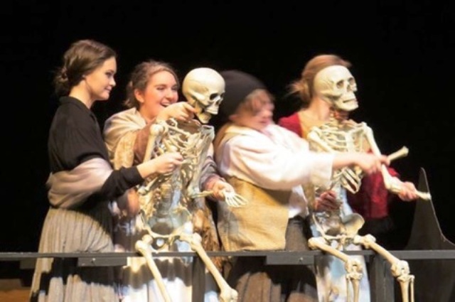 "(From left to right) Sophomore Ryan Vander Linde, senior Shirley Arnold, junior Abi Stocksdale, and senior Savanna Grant control two skeleton props in a comic scene of the one act production of ""The Passage"" as performed on the CSU Mainstage February 6th at Thescon. Due to a dedicated cast and crew, ""The Passage"" was a great success."