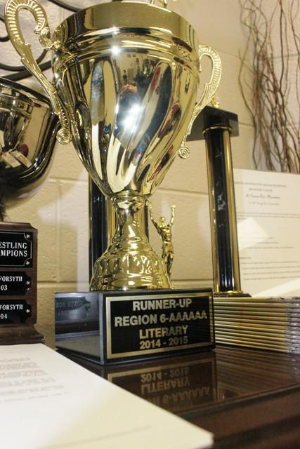 The trophy that the Literary winners won is currently placed in the Main Office. Please congratulate any of the winners if you see them.
