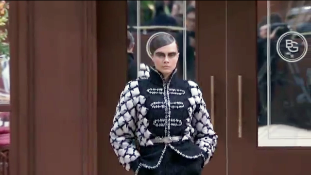 In Chanel, model Cara Delevigne started off the show with greased down hair and dark eye makeup.