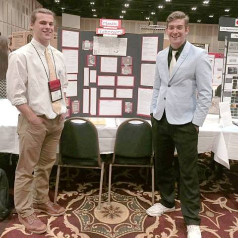 Junior Lance Mcgonigle and Noah Bieber stand in front of their science fair projects. The project won fourth place at the state Science fair in Athens, Georgia.