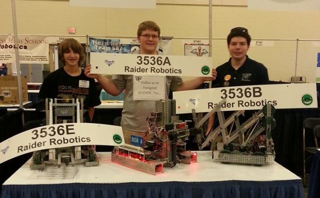 "Three competitors from North pose with their robots.  Students in the Robotics program spent many hours working on their robots.  ""We have to make sure everything on the robot is working and working at its maximum potential,"" Noah Thomas said."