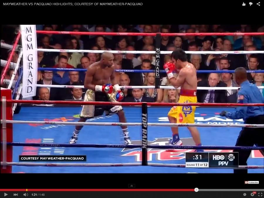 (Screenshot from YouTube) Floyd Mayweather and Manny Pacquiao square off in one of the most over hyped sporting events in history.