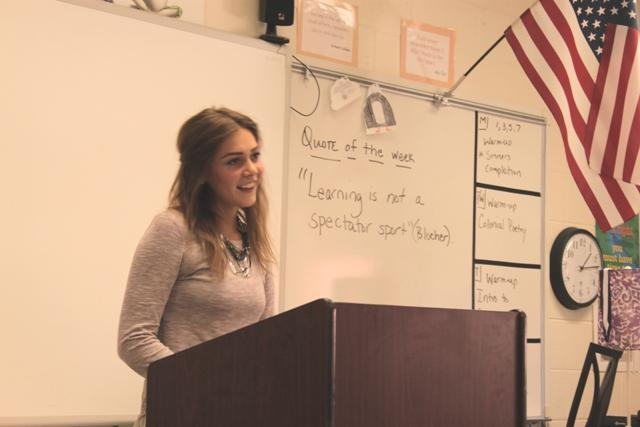 ": Senior Jessica Dickey stands in front of her fifth period class, Speech Forensics, to deliver a speech on ""what makes her, 'her'."""