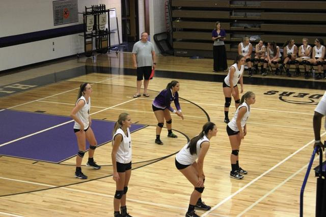 The North Forsyth Raiders and the Alpharetta Raiders position to prepare for the upcoming match. Photo taken by Sydney Grogan.
