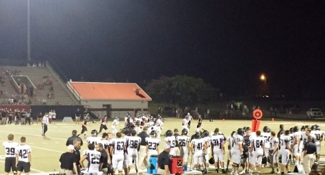 Raiders fight at the end zone to keep the Bulldogs from another touchdown.