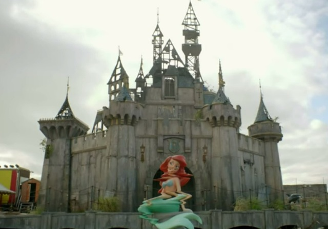 Theme parks are usually fun for the whole family, but Dismaland may not be suitable for children. Photo is a screenshot from video in article.
