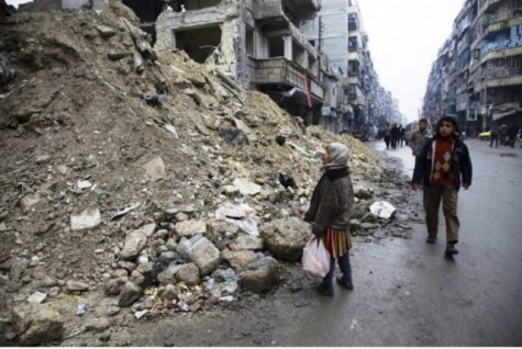 A Syrian girl pauses in awe of the destruction by the bombing run. She is one of millions of children who are struck by the horrors of this war. Photo source