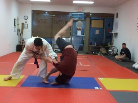 "An aikido practitioner throws his counterpart during his test to rise in ""belts"".  Aikido,  like Karate, is one of the martial arts to have emerged from the older fighting schools of Japan.    (Used with permission from the Butoku of North Georgia Facebook page)"