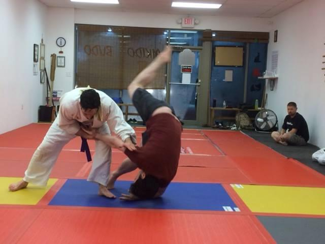 An+aikido+practitioner+throws+his+counterpart+during+his+test+to+rise+in+%E2%80%9Cbelts%E2%80%9D.++Aikido%2C%0A%0Alike+Karate%2C+is+one+of+the+martial+arts+to+have+emerged+from+the+older+fighting+schools+of+Japan.++%0A%0A%28Used+with+permission+from+the+Butoku+of+North+Georgia+Facebook+page%29