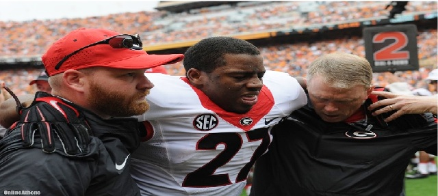 Nick Chubb was in severe pain after tearing ligaments in his left knee against The Tennessee Volunteers. Photo credit:  FLETCHER PAGE