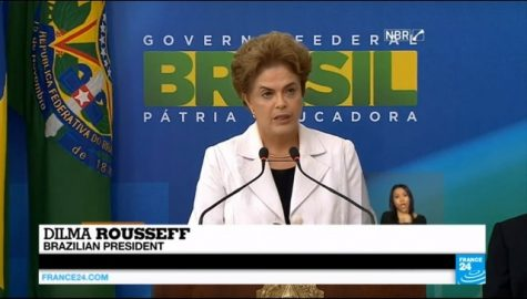 Brazilian President Dilma Rousseff has been fighting for her political life against politicians and protesters alike demanding her impeachment, but there is a small group of supporters convinced that the investigation against her is simply an attempt at a coup. These fiercely loyal government supporters are mostly made up of racially mixed working-class people who have benifited from innovative welfare policies implemented by the Workers' Party which have lifted an estimated 40 million out of poverty.