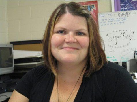 Mrs. Henke smiles through the stress of senior ads!