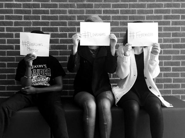 Students of North Forsyth High School stand with signs to represent groups they are a part of, but are scared to actively advocate for. All things in life have good and bad side to them, but when people have to hide their thoughts and beliefs because the word itself brings a nasty taste to people's mouths, there is a problem. All of these started out with good intentions, to help save people and bring equality, but are now tarnished by members within the advocacy group itself.