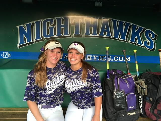 "Juniors Addie Harris, starting shortstop, and Madelyn Oliver, starting second baseman, celebrate in the North Georgia softball dugout after a motivating speech from Coach Henderson. ""Playing at North Georgia is a great experience,"" says Harris after the game, ""especially for the girls who are motivated to play collegiate softball."""