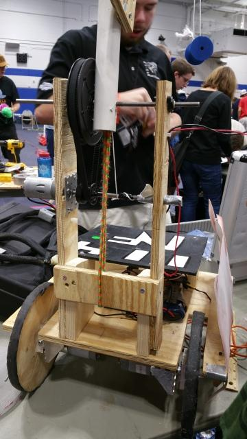 In this image, Noah Davis, makes a few final touches to the robot at the competition. The team's robot is meant to harvest corn with their arm design.