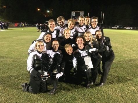 "The photo is of the officers after the band placed an overall 'Excellent"" ranking at the Collins Hill competition. Depicted in the photo is: Dory Owen (bottom left), Janie Milwood, Drey Woodson, Steven Burden, Marissa Dintino, Elizabeth Dollar, Daniella Hernandez, Anna Grace Brown, Mathew McFadden (top left), Johnathan Buwalda, Bailey Kenzivich, Mikayla Eardhart, Luke Fizone, and Steven Kemp (top right)."