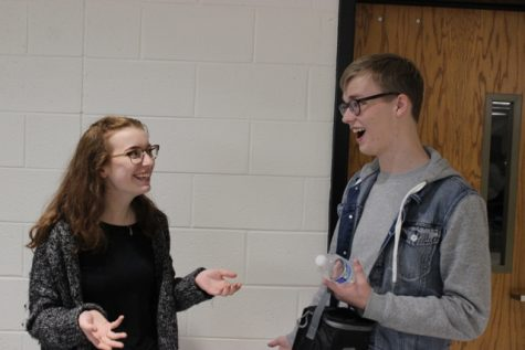"Junior Sophie Bier (left) tells peer Noah Smith (right) an intense story in which she uses the word ""wild"" to describe the situation. The adjective wild is an extremely useful word that is often overlooked and not given credit for its value."