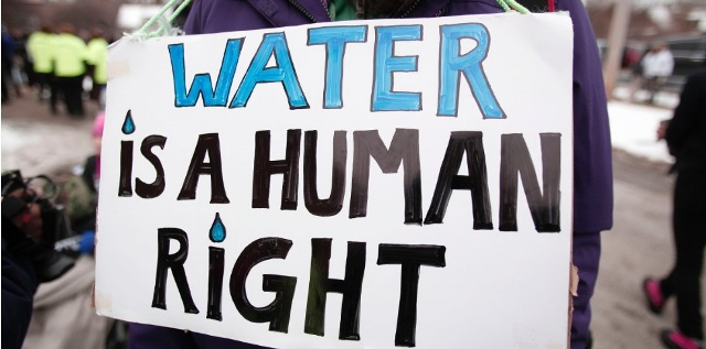 Many people protest in Flint, Michigan the government's inaction regarding the amount of impure water in the town and advocate for the clean water supply in the name of human rights. Credit for the photo goes to Business Insider.