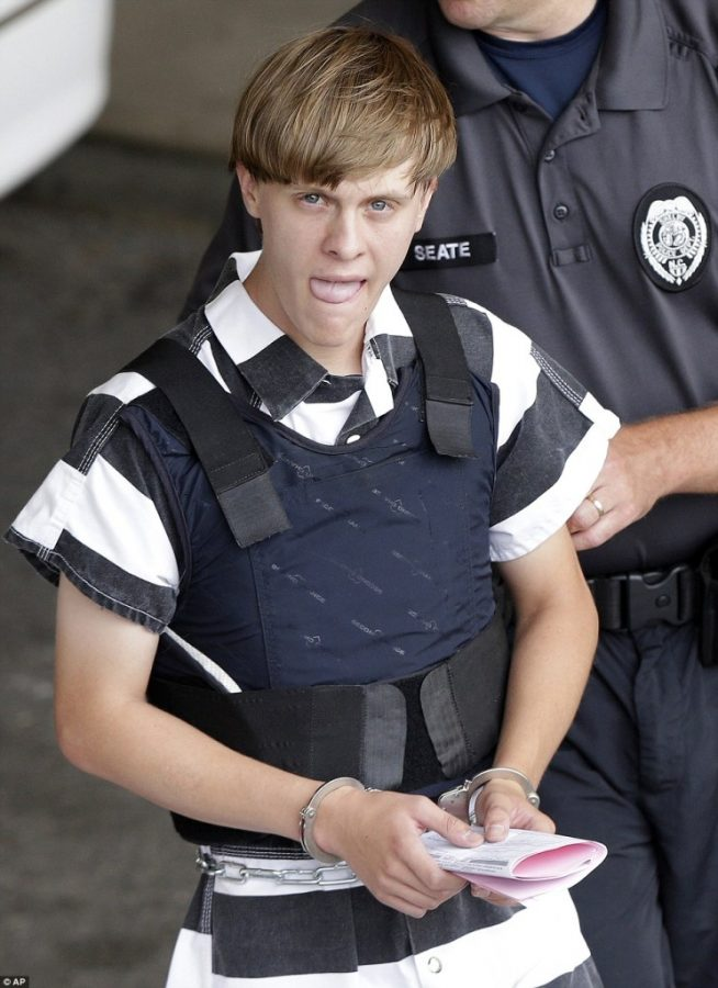 Dylan Roof being escorted to his court hearing in his prison uniform.