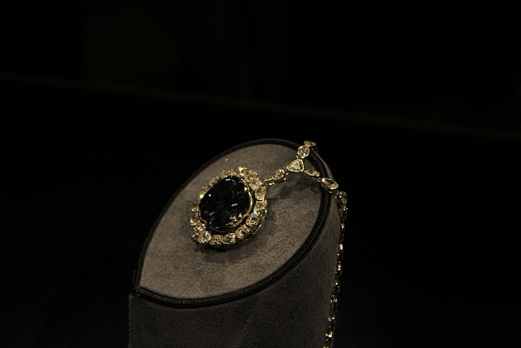 Here is a picture of the infamous Hope Diamond in its case at the Museum of Natural History. The necklace has not been touched or cursed anyone since being at the Museum.